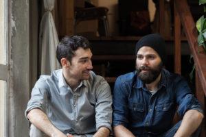 2 young men talking